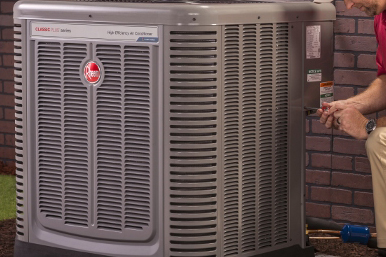 Edwards Plumbing and Heating Iowa Rheem Air Conditioner Outside Condenser