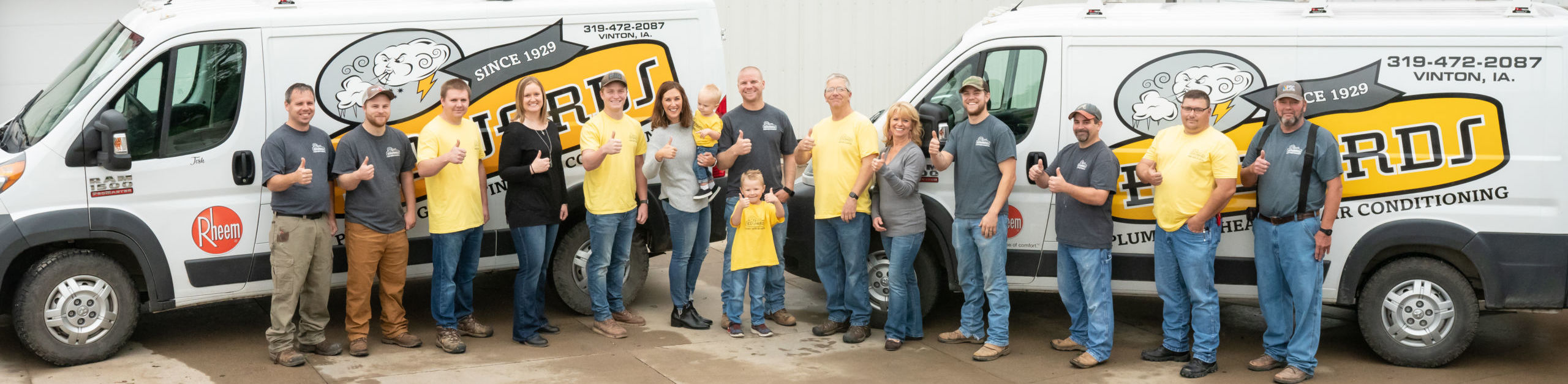 Edwards Plumbing and Heating Team in Front of Service Trucks